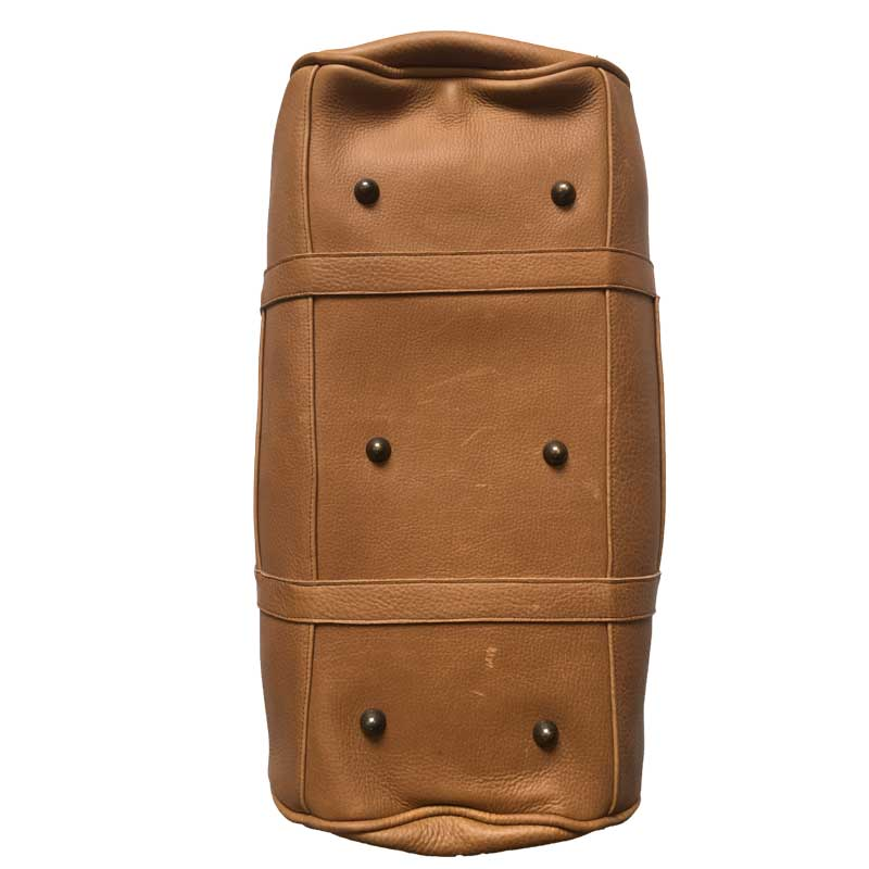 Illustration du dessous du sac de voyage homme en cuir